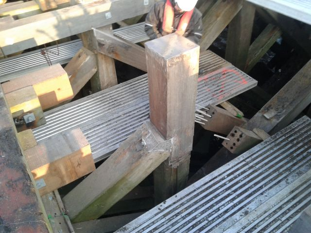 Restauration of the wooden piles and beams of the Westerstaktsel in Ostend-One of the longest wooden piers in the world